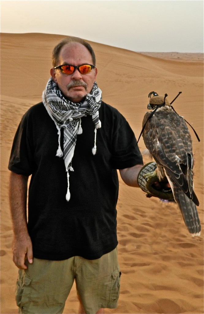 self-portrait with falcon/desert outside of Dubai, UAE